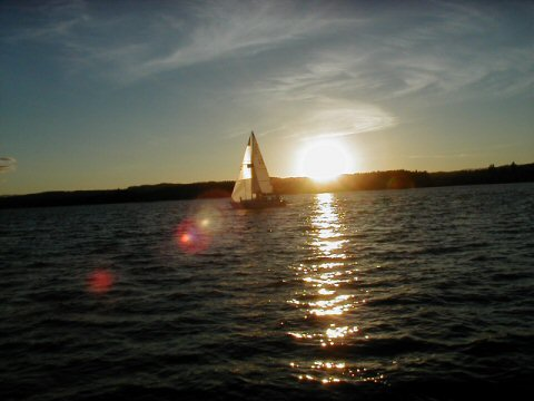 sail boat with lens flare